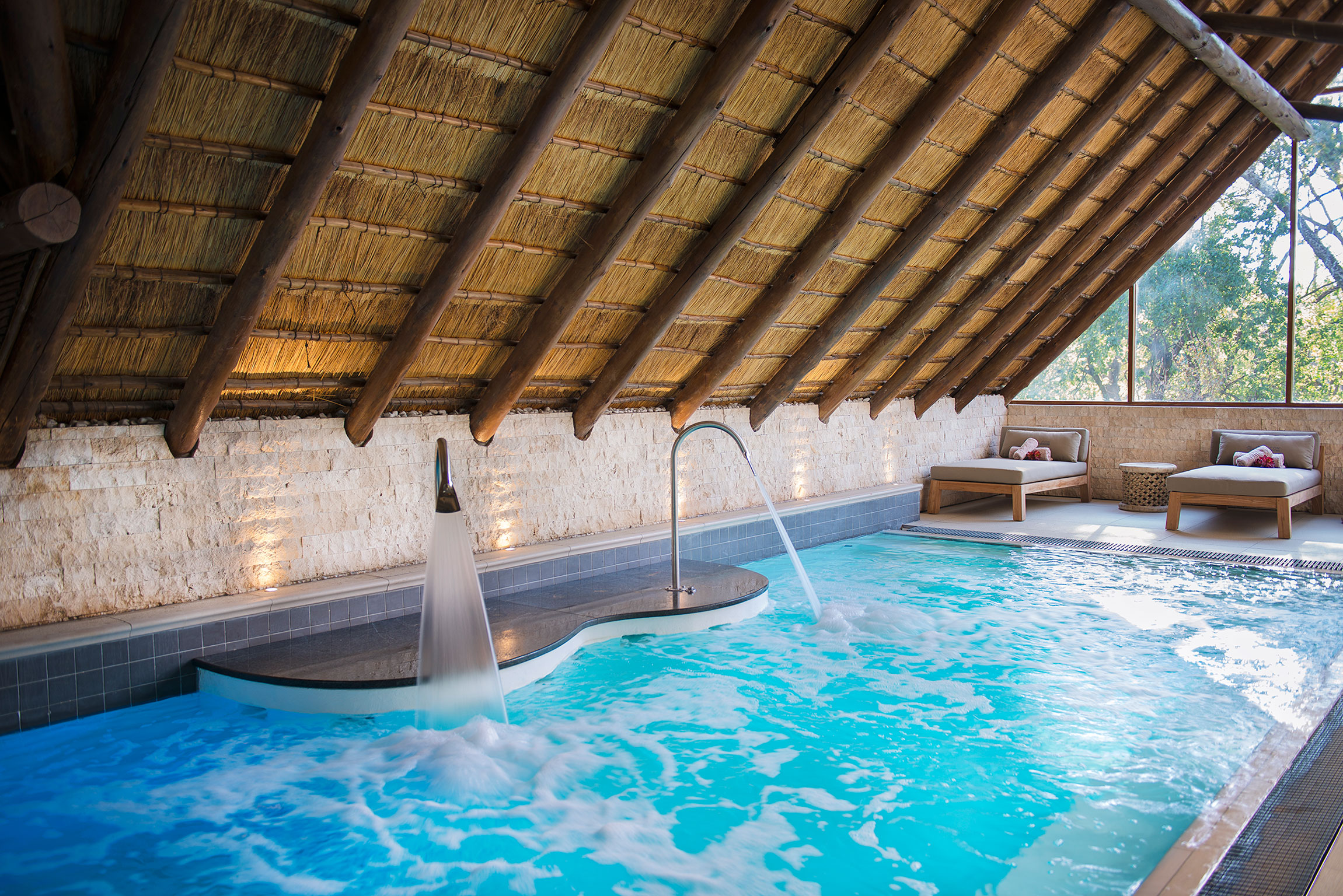 Our award-winning spa treatment rooms overlook the dam
